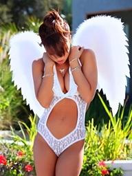Capri Anderson wearing her cutie wings,..