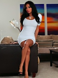 Anissa Kate models her tight white suit..